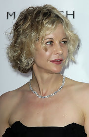 Meg Ryan wore her usual curly bob at the de Grisogono party.