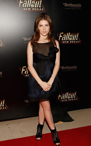 Anna Kendrick added a touch of edge to her look with a pair of black open-toe ankle boots.