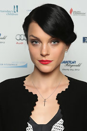 Jessica Stam's bright red lipstick provided a striking pop against her black-and-white outfit.