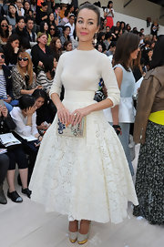 A pair of embroidered white pumps with gold platforms polished off Ulyana Sergeenko's lovely ensemble.