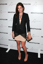 Julia Restoin-Roitfeld injected some shine via a metallic gold pillow clutch by Genevieve Jones.