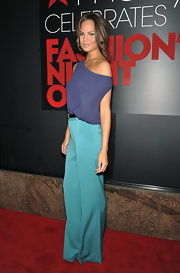 Chrissy Teigen paired her top with turquoise pants for a chic color combination during Fashion's Night Out.