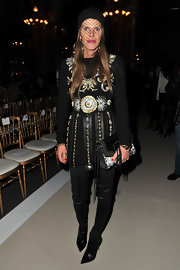 Anna dello Russo looked every bit the fashion icon in an intricately beaded LBD by Fausto Puglisi during the Balmain fashion show.
