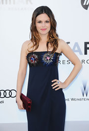 Rachel Bilson's red satin clutch provided a chic color contrast to her midnight-blue dress at the amfAR Cinema Against AIDS Gala.