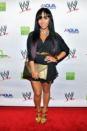 Nicole Polizzi added shine via gold platform sandals with wide crisscross straps.
