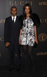 Liya Kebede glammed up her mini dress with a black fur cape.
