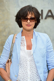 Ines de la Fressange attended PFW wearing a lax look and a pair of printed-frame sunnies.