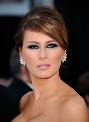 Melania Trump's smoky eyes gave her classic look some edge at the 83rd Academy Awards.
