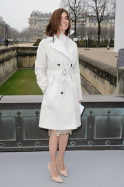 Carine Roitfeld arrived for the Christian Dior fashion show wearing a classic white trenchcoat.