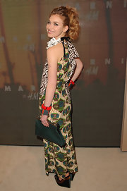 Imogen Poots attended the Marni x H&M collection launch carrying an oversized green clutch.