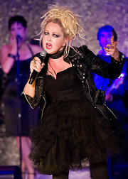 Cyndi Lauper hit the Betsey Johnson runway show wearing a strapless tutu dress and a leather jacket.