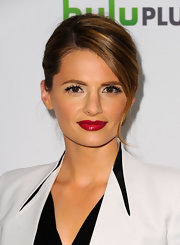 Stana Katic polished off her look with a bold red pout.