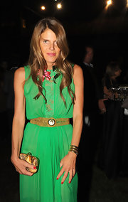 Anna dello Russo styled her dress with a gold chainmail belt for a chicer finish.