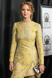 Jennifer Lawrence accessorized her chic cocktail dress with a metallic silver clutch by Roger Vivier when she attended the Los Angeles Film Critics Association Awards.