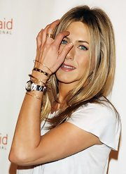 For her bling, Jennifer Aniston chose some stackable rings along with a load of gold bangles.