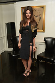 Julia Restoin-Roitfeld attended the Casadei dinner looking sporty-chic in a gold-embroidered track jacket.