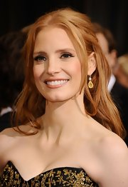 Jessica Chastain got all glammed up with a pair of yellow diamond drop earrings by Harry Winston for the Oscars.