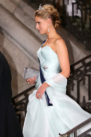 Princess Tatiana paired a silver clutch with a pale blue gown for the wedding of Princess Madeleine of Sweden and Christopher O'Neill.