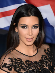 Kim Kardashian went heavy on the black eyeshadow for a dramatic beauty look.