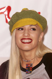 Gwen Stefani topped off her look with a colorful knit newsboy cap during the Artists Against AIDS Worldwide press conference.