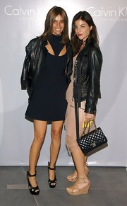 Julia Restoin-Roitfeld topped off her ensemble with a classic quilted Chanel bag.