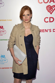 Jessica Chastain arrived for the Coach benefit looking stylish in a beige trenchcoat layered over a navy dress.