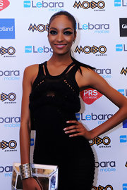 Jourdan Dunn accessorized with an extra-wide silver cuff during the MOBO Awards.