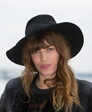 Lou Doillon tamed her disheveled locks with a black walker hat for the Midem photocall.