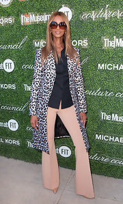 A leopard-print coat finished off Iman's ensemble in fierce style at the Couture Council Fashion Visionary Awards.