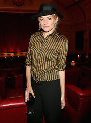 Sienna Miller was menswear-chic in a Burberry striped button-down at the London screening of 'About Time.'