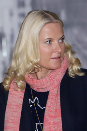 Princess Mette-Marit looked liked a doll with her platinum-blonde curls while visiting the Scandic Vulkan Hotel.