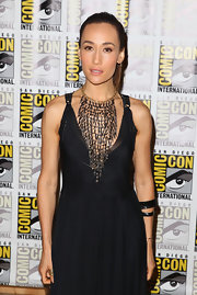 This spiky bib necklace added major oomph to Maggie Q's dress at the 'Divergent' press line at Comic-Con.