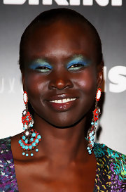 Alek Wek went for a bold beauty look with lots of blue and green eyeshadow when she attended the Miss Bikini Luxe fashion show.
