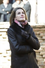 Princess Letizia looked toasty in black leather gloves teamed with a fur-lined coat during her visit to Tarazona.