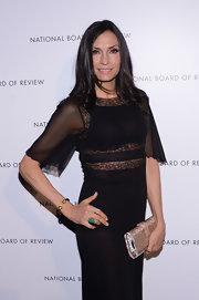 Famke Janssen added a touch of glam to her outfit by carrying a metallic purse at the National Board of Review Awards.