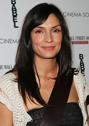 Famke Janssen went simple and natural with less makeup on and hair unstyled at a movie screening.