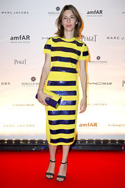 Sofia Coppola continued the yellow and purple motif with a Marc Jacobs plexi clutch.