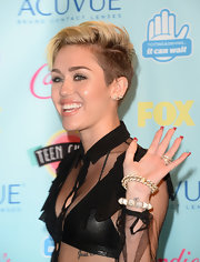 Miley Cyrus sported a ton of bling at the 2013 Teen Choice Awards, including an edgy-glam pyramid stud bracelet.