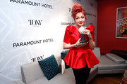 The legendary Cyndi Lauper showed off her trophy at the Tony Awards wearing black pants and a standout peplum top.