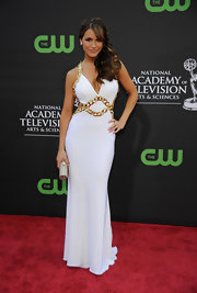 Chrishell Stause complemented her dress with a gold tube clutch.