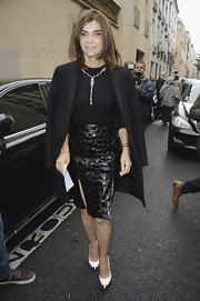 Carine Roitfeld wore a luxe textured leather pencil skirt with double slits to the Balmain fashion show.