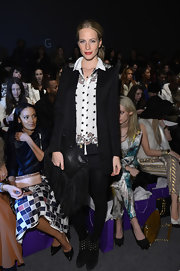 Poppy Delevingne was spotted at the Noon by Noor fashion show wearing a black blazer with studded shoulders.