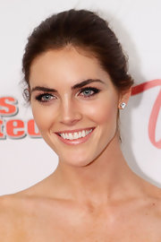 Hilary Rhoda attended the Club SI Swimsuit event wearing an effortlessly chic bun.