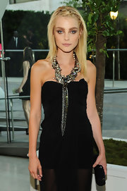 Jessica Stam teamed a black tube clutch with a strapless dress and a statement necklace for the CFDA Fashion Awards.
