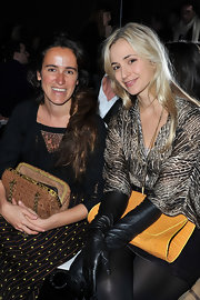 Elisabeth von Thurn und Taxis went for edgy styling with a pair of black leather gloves at the Giambattista Valli Fall 2012 show.