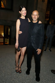 Hanneli Mustaparta chose a pair of black cross-strap platform sandals to team with her dress.