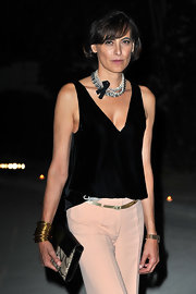 Ines de la Fressange held a python-skin purse at Karl Lagerfeld's show.