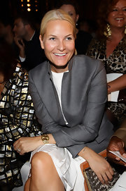 Princess Mette-Marit accessorized with a chic gold watch at the Emilio Pucci Spring 2011 show.