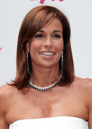 Christina Parodi went for a pair of shoulder-sweeping diamond earrings at an event in Milan.