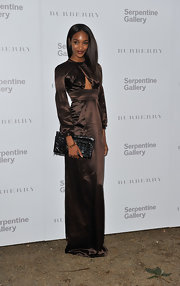 Jourdan Dunn styled her dress with a large black leather clutch.